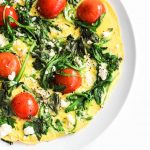 Stovetop frittata with tomatoes, arugula, feta, and basil