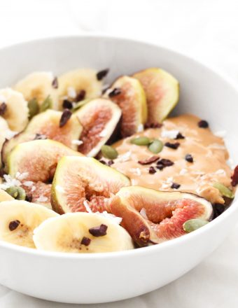 Chia tea oatmeal topped with banana, figs, and peanut butter