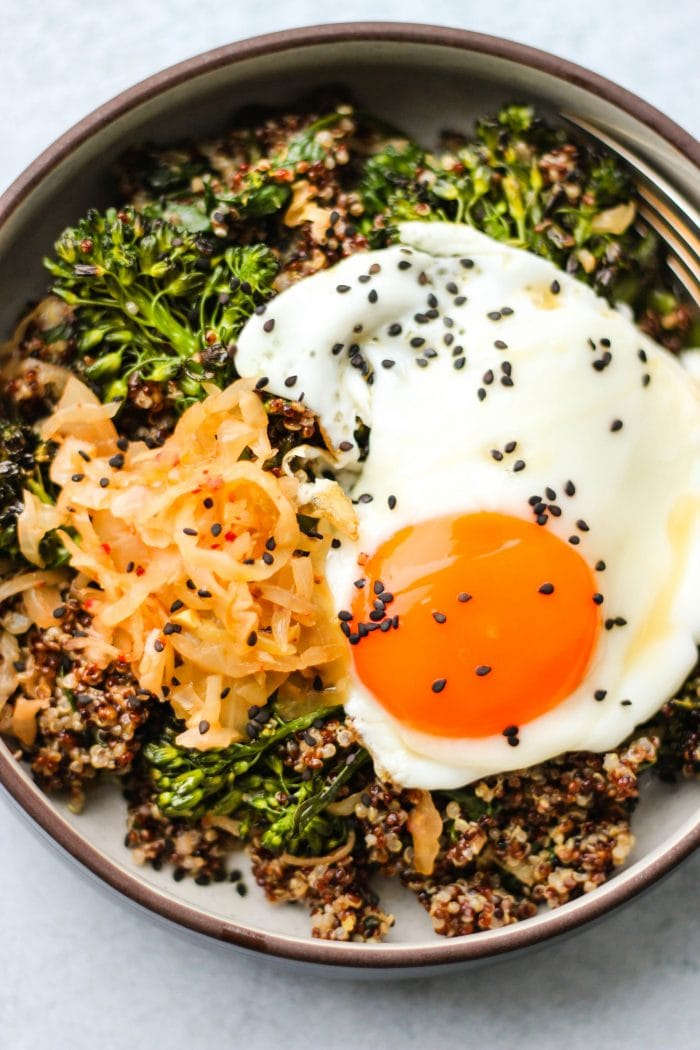 quinoa, kimchi, broccolini, and egg in bowl