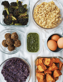 Batch cooking and meal prep ingredients laid out in tupperware containers