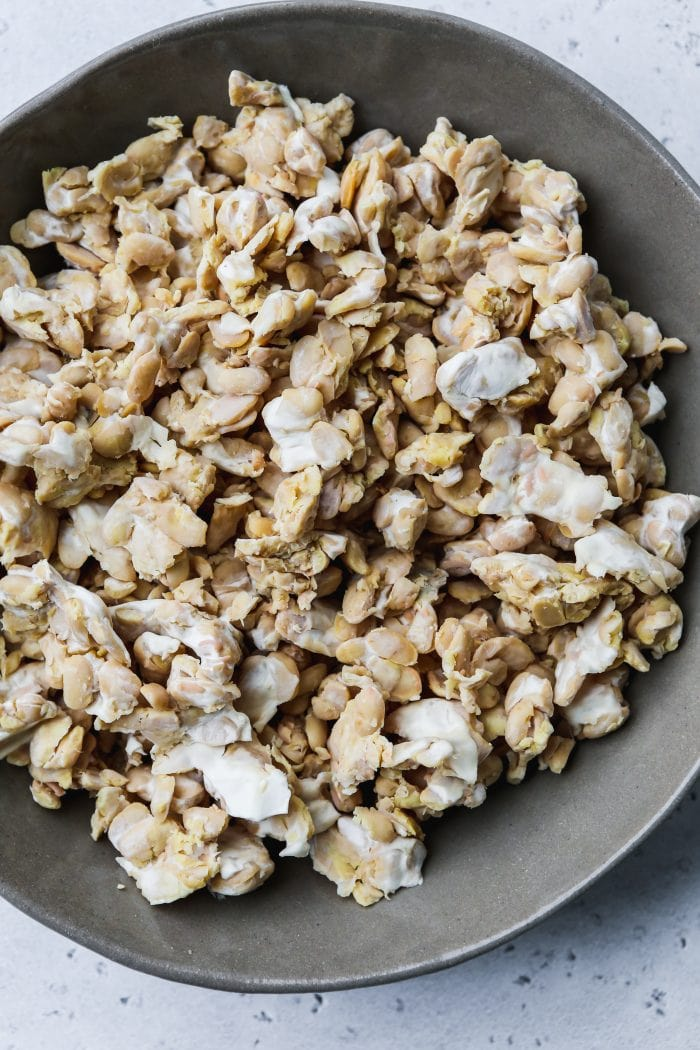 overhead photo of a grey bowl filled with crumbled, ground tempeh