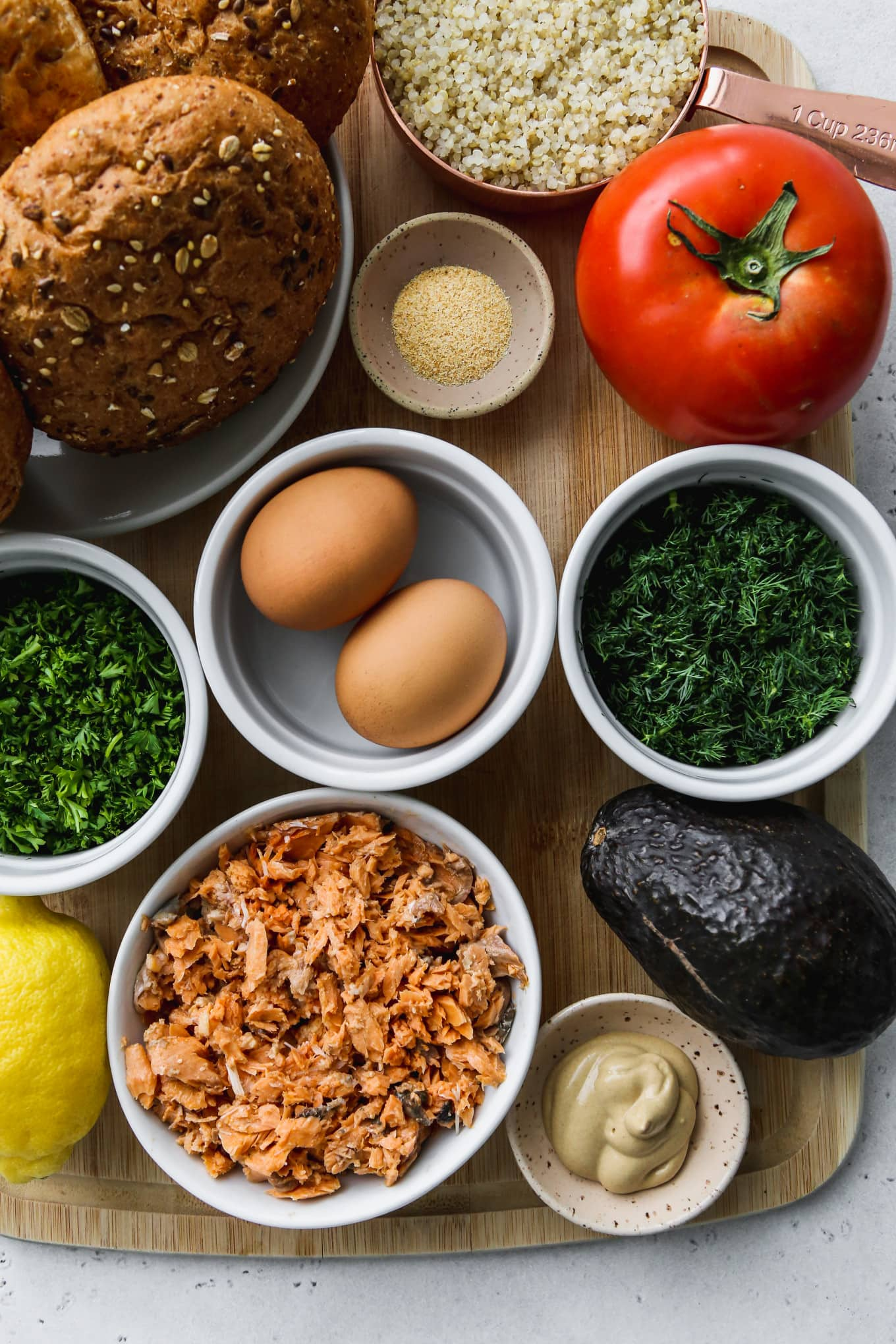 Overhead photo with small bowls of ingredients on top of a wooden cutting board.