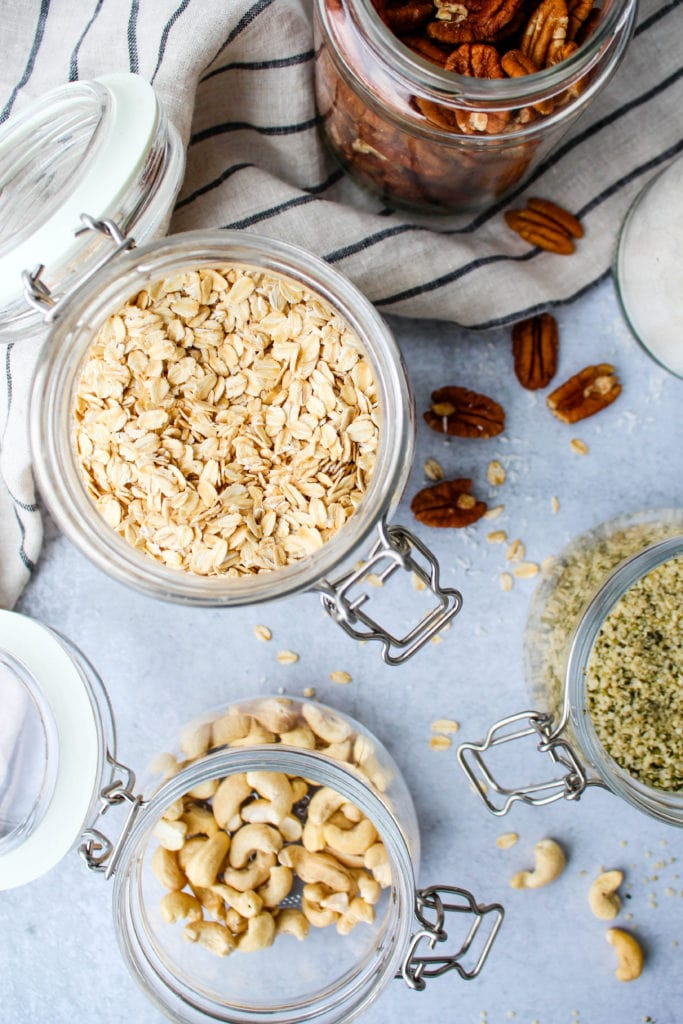 bird's eye view of glass jars with various nuts and seeds