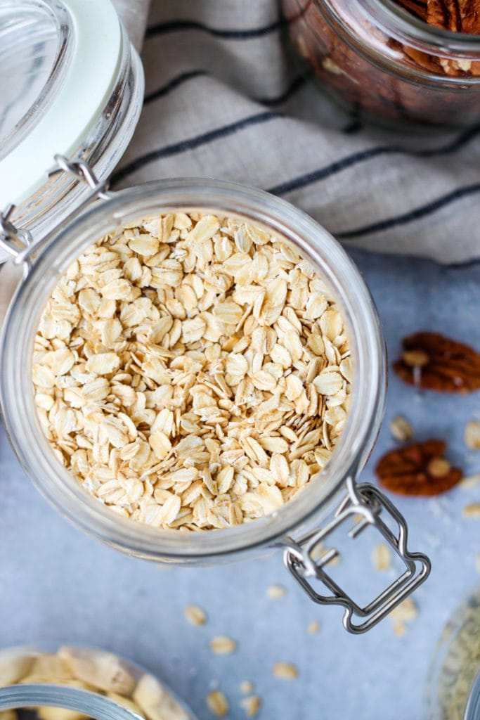 glass jar of rolled oats to be used as cow's milk alternative