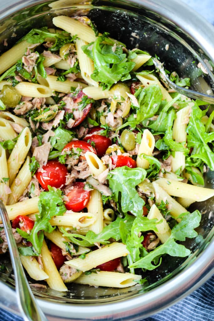 canned tuna pasta salad with arugula, tomatoes, and olives