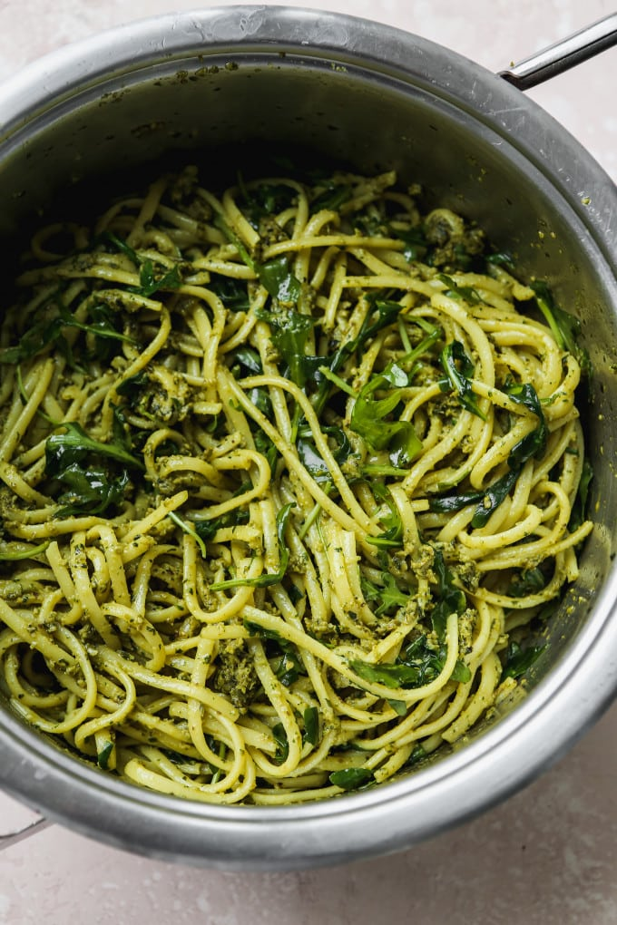 Overhead photo of a saucepan filled with pesto linguine pasta.