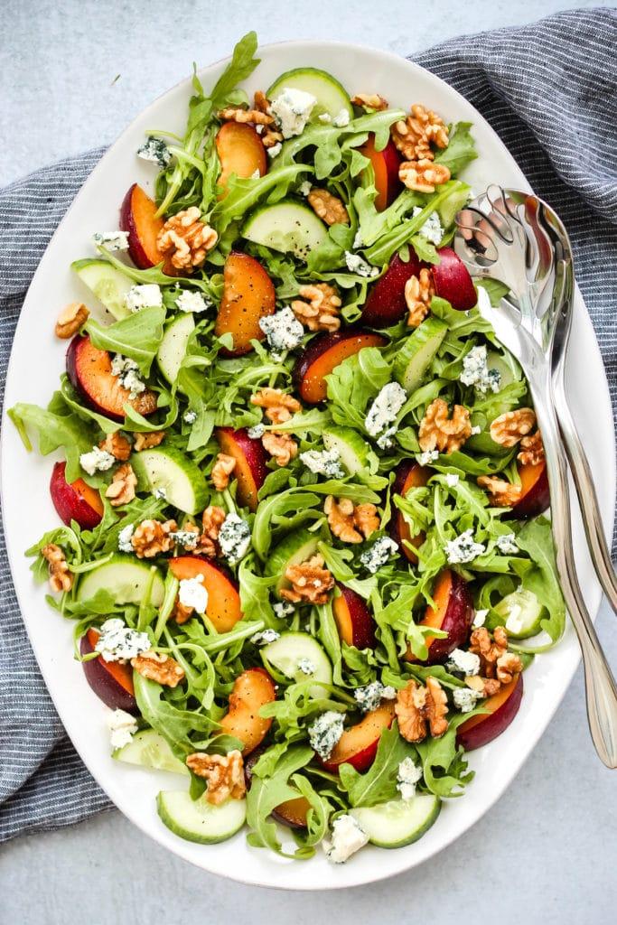 plum salad with arugula, blue cheese, walnuts, cucumber