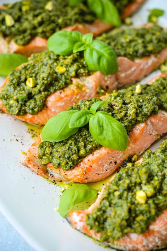 easy baked salmon topped with pistachio pesto