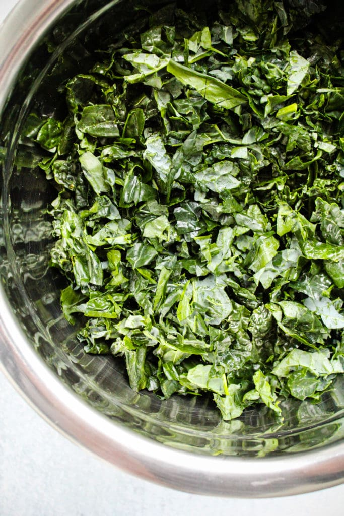shredded kale in a mixing bowl