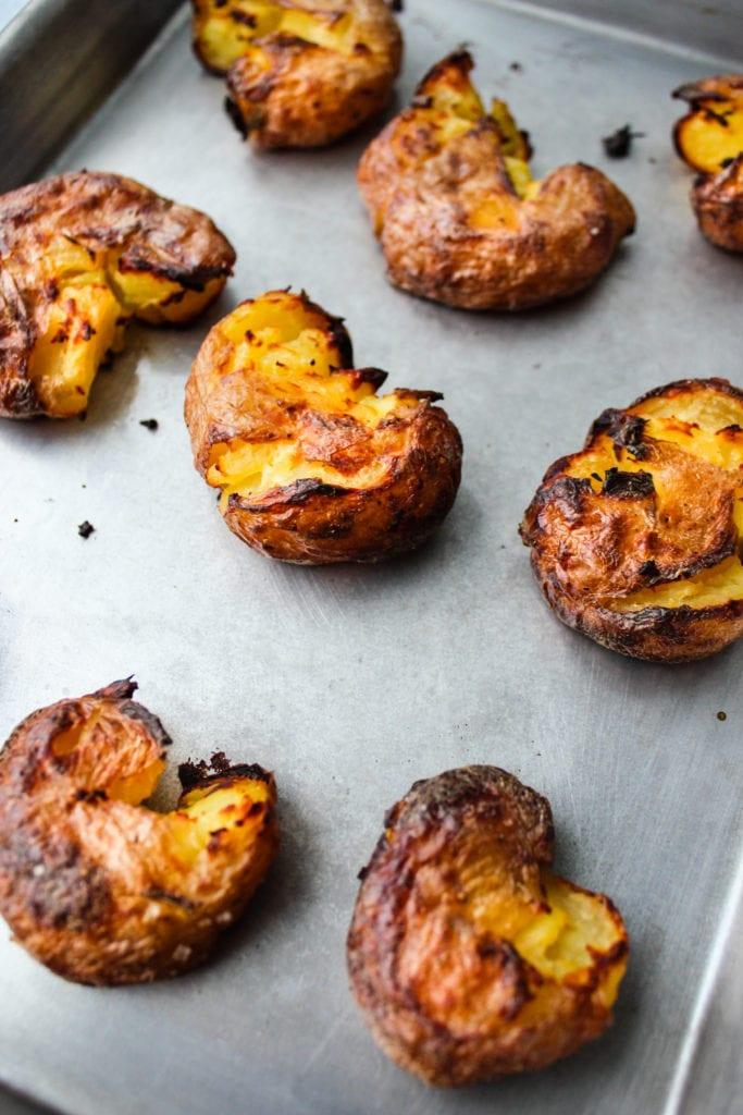 crispy smashed red potatoes on baking sheet