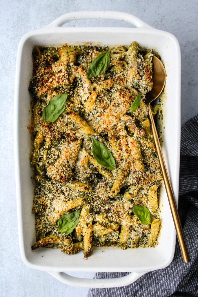 white casserole dish with baked pesto pasta