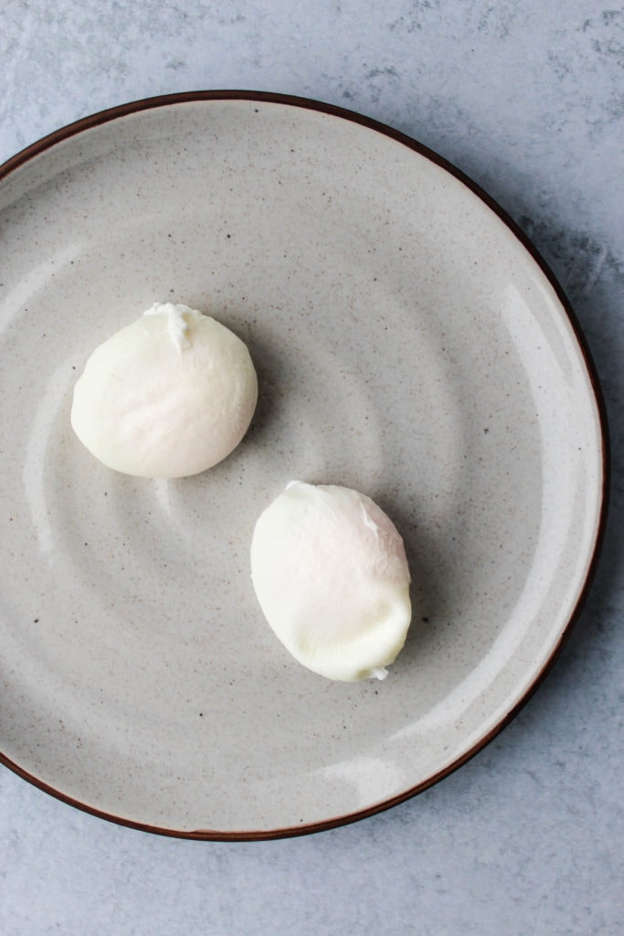 two poached eggs on plate