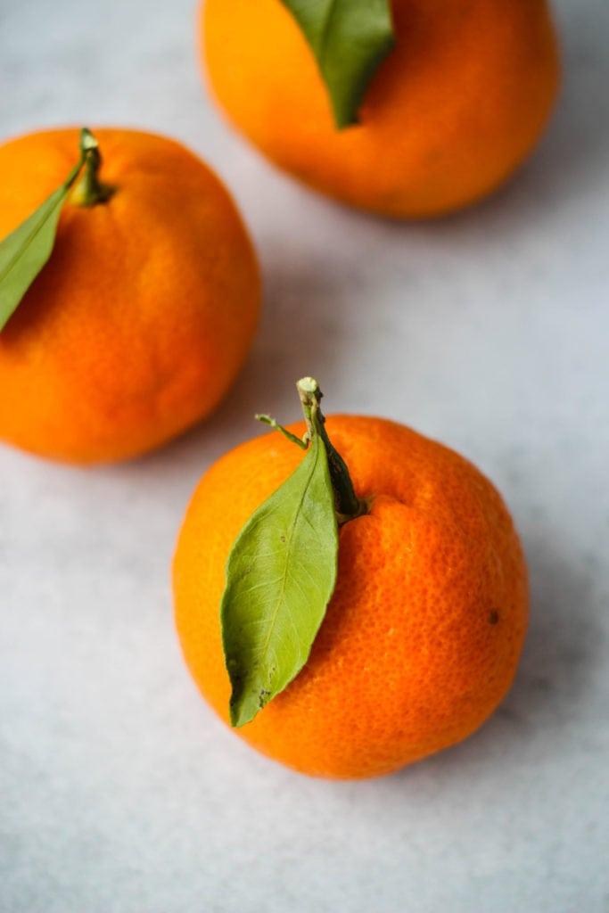 three mandarin oranges with stem