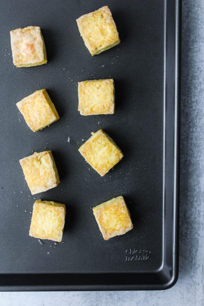 baked tofu cubes on baking dish