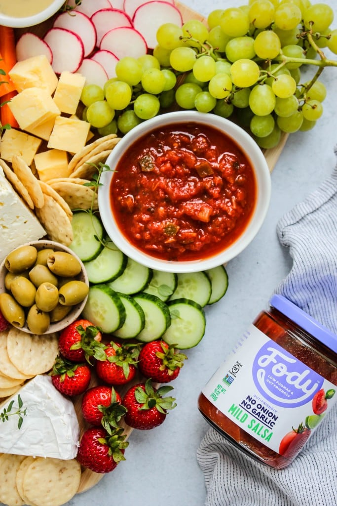 cheese board with fody foods salsa