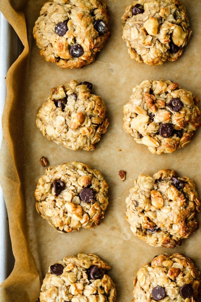 overhead shot of eight tahini oatmeal cookies on parchment paper