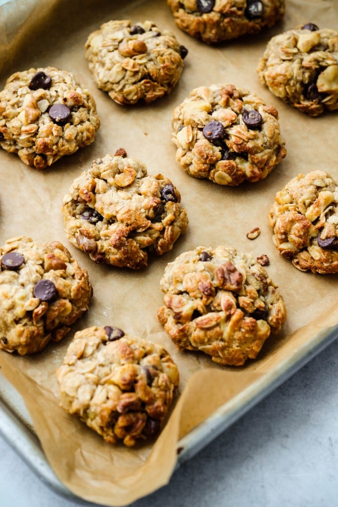 parchment lined baking dish with tahini oatmeal cookies