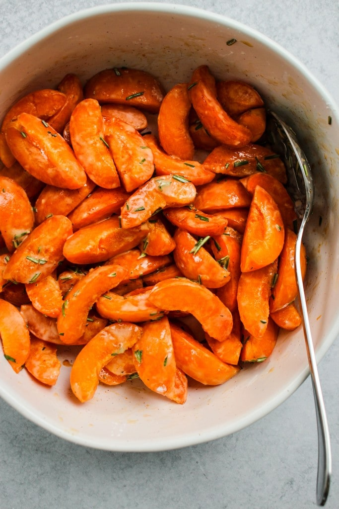 sliced apricots tossed in a white bowl
