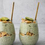 side angle of two glass jars with key lime pie chia pudding parfaits