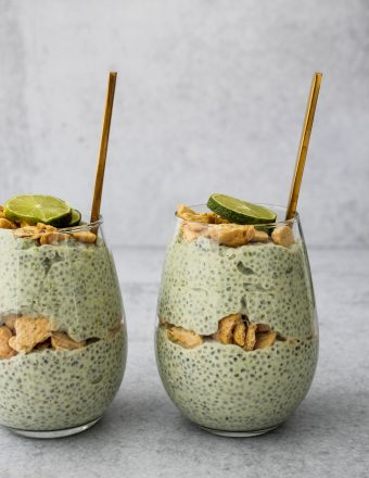 side angle of two glass jars with key lime pie chia pudding parfaits