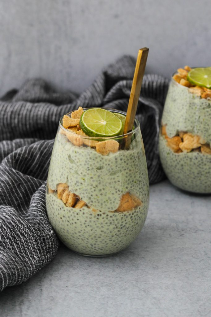 glass jar with key lime pie chia pudding and graham cracker parfait