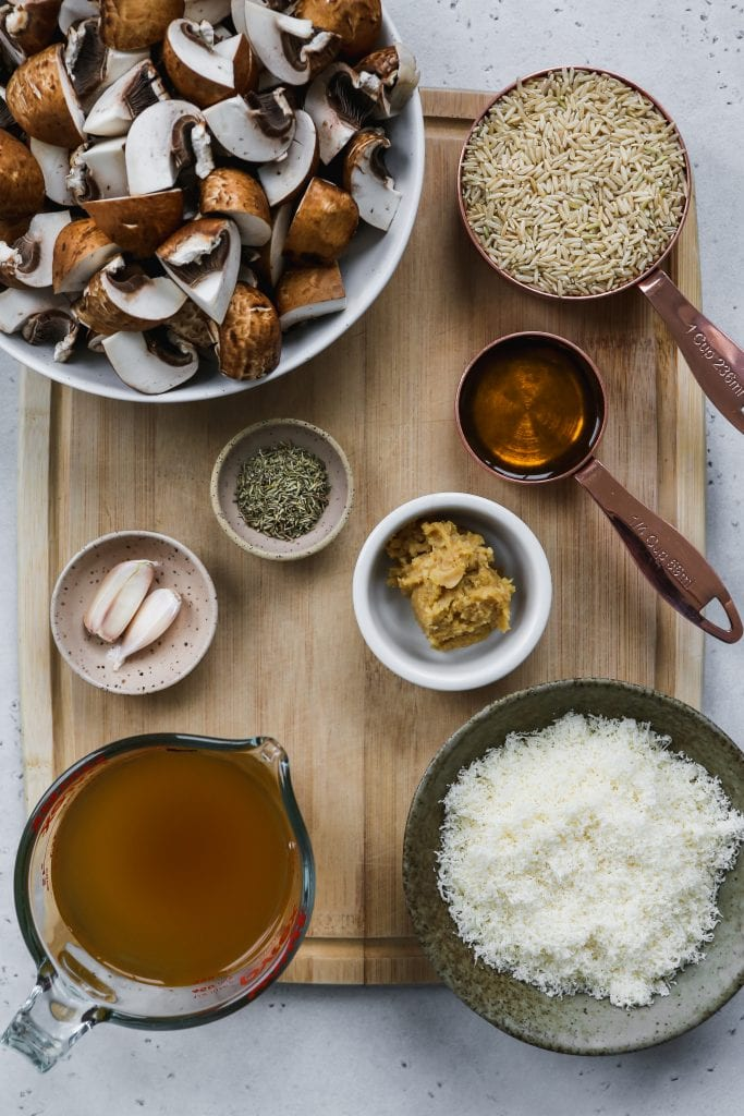 overhead shot of wood cutting board with bowls of ingredients on top
