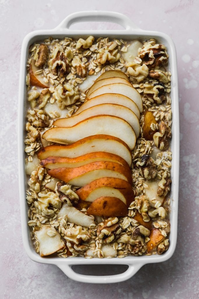 overhead photo of white baking dish with uncooked pear oatmeal