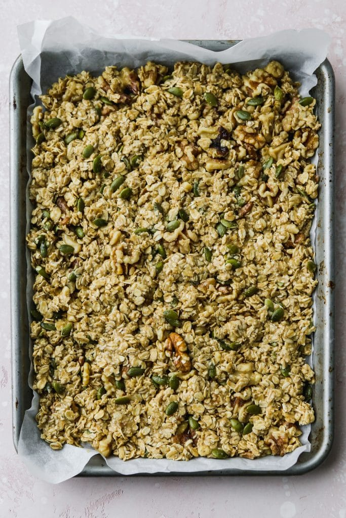 overhead photo of baking sheet with un-baked granola on top