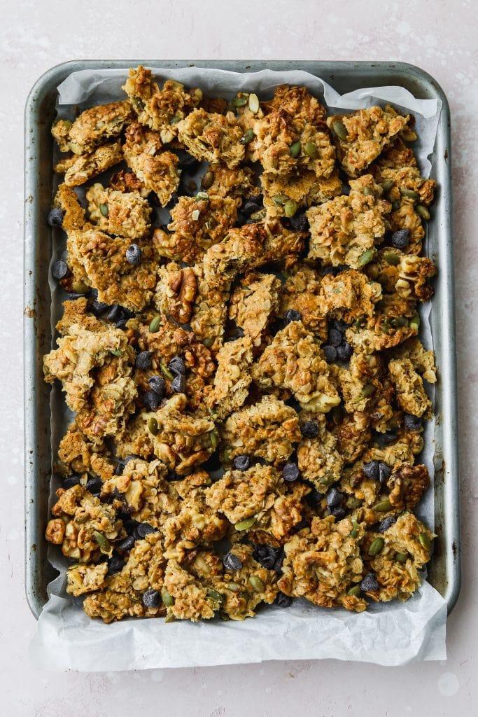 overhead photo of baking sheet of homemade tahini granola