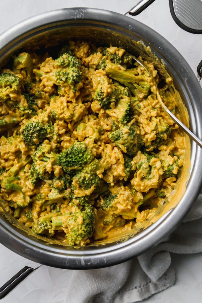 overhead photo of pot filled with vegan cheesy broccoli rice