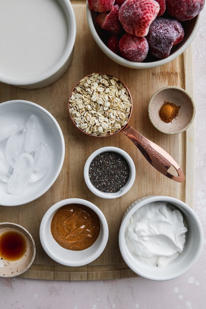 overhead photo of white bowls of ingredients on top of a wood cutting board