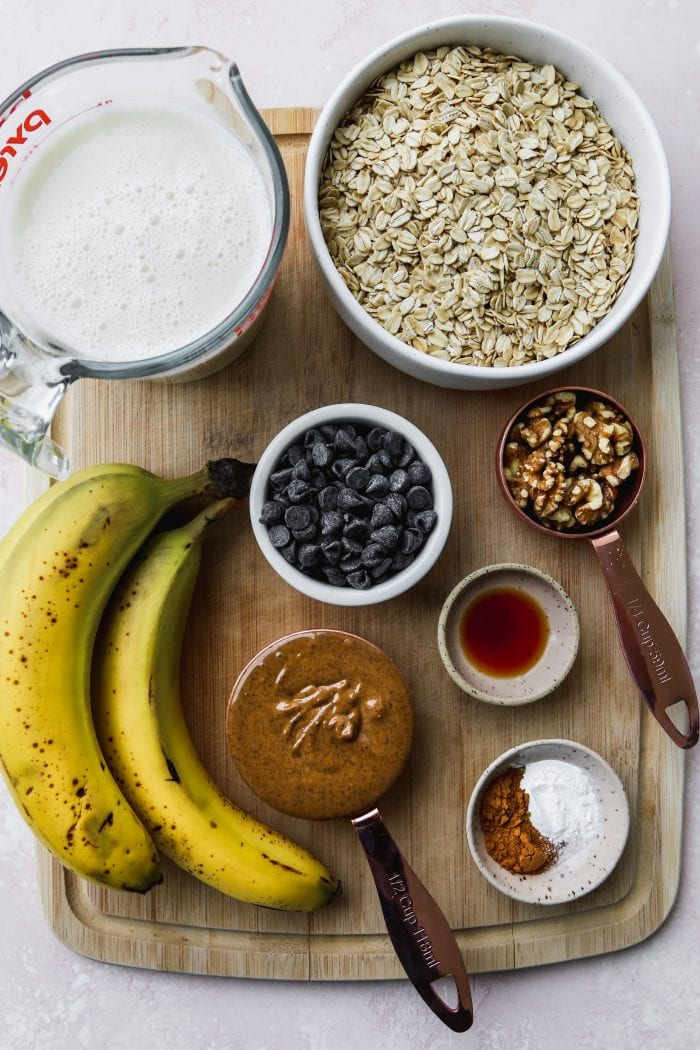 Overhead photo of small bowls of ingredients on top of a wooden cutting board.