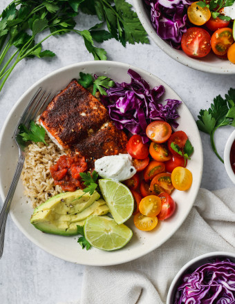 Overhead photo of a taco salmon rice bowl with vegetables.