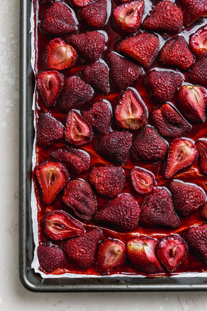 Overhead photo of balsamic roasted strawberries on a baking sheet.