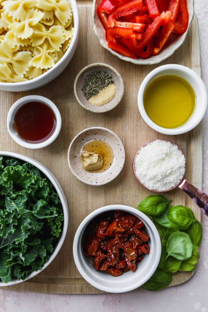 Overhead photo of small bowls of ingredients on top of a wood cutting board.