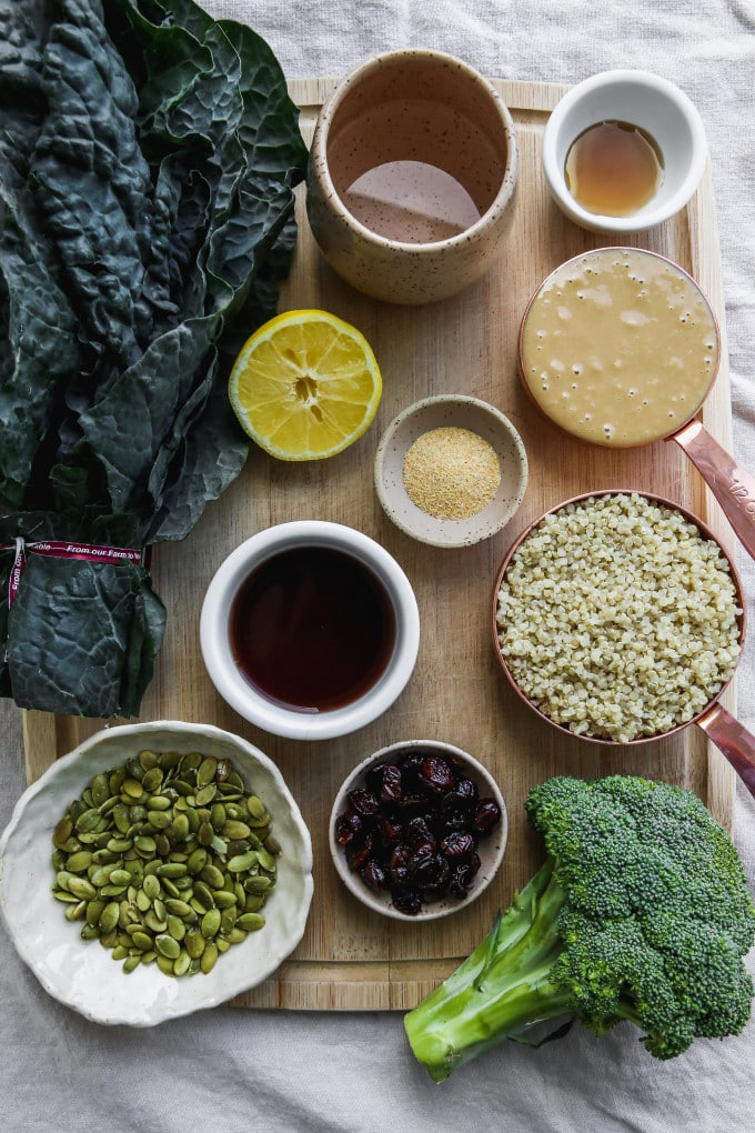 Overhead photo of small bowls of ingredients on a wood cutting board.